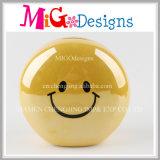 Tirelire en céramique d'Emoji de sourire terrible/tirelire