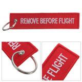 제거한다 비행 자수 Keychain 직물 물자 Keychain의 앞에 타자를 치십시오