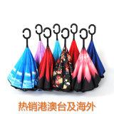 熱い販売の逆の逆さまの傘によって逆にされる裏返しの傘