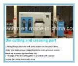 Máquina que corta con tintas del cristal de exposición