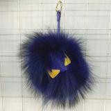 Il mostro blu scuro della sfera della pelliccia del Raccoon della Cina fa la pelliccia POM Keychain dei giocattoli della pelliccia