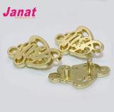 Значок металла цвета золота элегантности для одежды и мешка