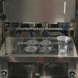 縦の真空の豆乳のコップのシーリング機械