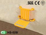 Assento de dobramento fixado na parede do chuveiro do banho da cadeira de chuveiro