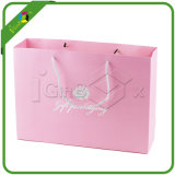 Sacs de cadeau et cadre roses de palier pour des accessoires