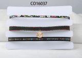 Tre righe di multi collana del Choker del tessuto di PU&Suede di colore