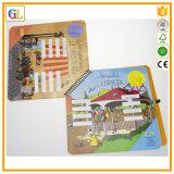 Impresión del libro de niños en el atascamiento espiral con la pluma