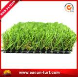 Mattonelle artificiali del tappeto erboso dell'erba di plastica popolare dal cinese