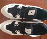 Pattini casuali di sport delle scarpe da tennis per gli uomini/donne