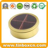 Caixa redonda do estanho do alimento com o indicador desobstruído para doces de chocolate