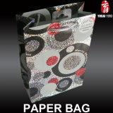 Sacs bon marché personnalisés de cadeau de papier d'imprimerie de noir en ivoire