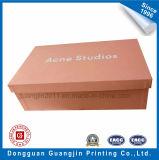 Розовым напечатанная цветом коробка бумажного твердого ботинка упаковывая с серебряным логосом
