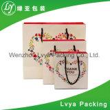 Sacs en papier de achat pliables cosmétiques de Papier d'emballage de métier fait sur commande de marque d'usine