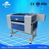 趣味小型CNCの二酸化炭素レーザーの彫版の打抜き機のためのチーナン中国の専門の製造者