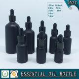 Bouteille en verre colorée noire mate d'huile essentielle
