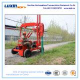 Maquinaria da construção de estradas para a instalação do borne do Guardrail