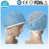 Protezione non tessuta medica a gettare dell'infermiera dei pp con il legame sopra