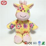 La giraffe bourrée par peluche heureuse de fantaisie de qualité de cadeau d'usager badine le jouet