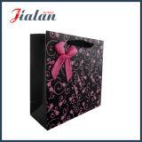 Sacco di carta in pieno stampato di marchio di colore rosa caldo con l'arco del nastro