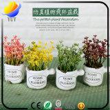 Planta simulada exquisita con el florero para la decoración