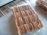 Filas multi en la empaquetadora del borde para las galletas