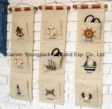 Le jute pratique à la maison d'organisateur de 5 poches marque avec des lettres naturellement le sac de mémoire de tenture