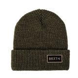Sombrero barato de la gorrita tejida del Knit de la venta caliente con la insignia de cuero de la corrección
