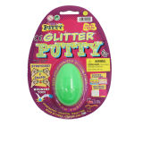 Funkeln-dumme Kitt-Spielwaren im Plastikei