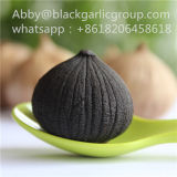 Определите заквашенный черный чеснок с кожей