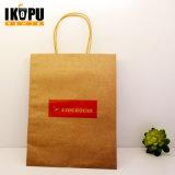 Commercio all'ingrosso del sacchetto stampato disegno piano della carta kraft della maniglia di modo