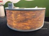 Bureau de comptoir de réception rond rétro-éclairé à surface continue en acrylique et à surface solide acrylique