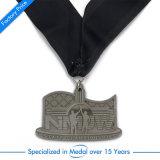 Medaglia d'ottone antica del ricordo con la sagola