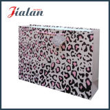 La impresión del leopardo modifica la bolsa de papel para requisitos particulares barata de la alta calidad de las ventas al por mayor de la insignia