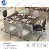 Tabella pranzante elegante con il tavolo di marmo