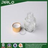 5ml小型贅沢なガラス香水瓶は金の帽子が付いている小さいガラス芳香のびんを形成した