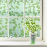 El verde decorativo helado de la película translúcida de la ventana deja las etiquetas engomadas de cristal