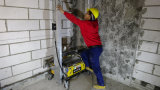 自動コンクリートの壁のレンダリングのミキサー機械
