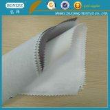 Tessuto della camicia di cotone con scrivere tra riga e riga