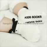 Strickende Baby-Form-Art-flippige Socken