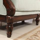 Strato classico del tessuto dell'oggetto d'antiquariato del sofà del salone con testo fisso intagliato di legno