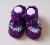 赤ん坊のカシミヤ織の糸の靴は赤ん坊の屋内ソックスを強打する