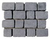 Cubes gris en granit de trottoirs de progression de jardin