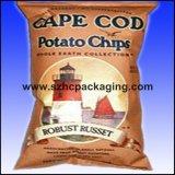 관례에 의하여 인쇄된 감자 칩은 도매로 자루에 넣는다