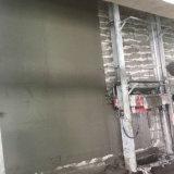Construction de mur en béton de brique plâtrant le monophasé de machine