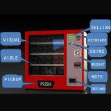 Preservativo in un distributore automatico del piccolo cambio e della casella