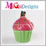 セービングのお金の硬貨ボックスのための着色されたカップケーキ