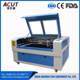 vers le haut de vers le bas ajourner et prix automatique de machine de gravure de laser de CO2 de commande numérique par ordinateur d'orientation