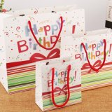リボンのハンドルのペーパー光沢のあるアートペーパーのギフト袋が付いている高品質の誕生日プレゼント袋