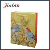 Personnaliser avec le sac de cadeau d'achats de main de papier en ivoire d'oiseaux de scintillement