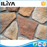 Pedra artificial, mão - pedra cultural feita, tijolo da parede